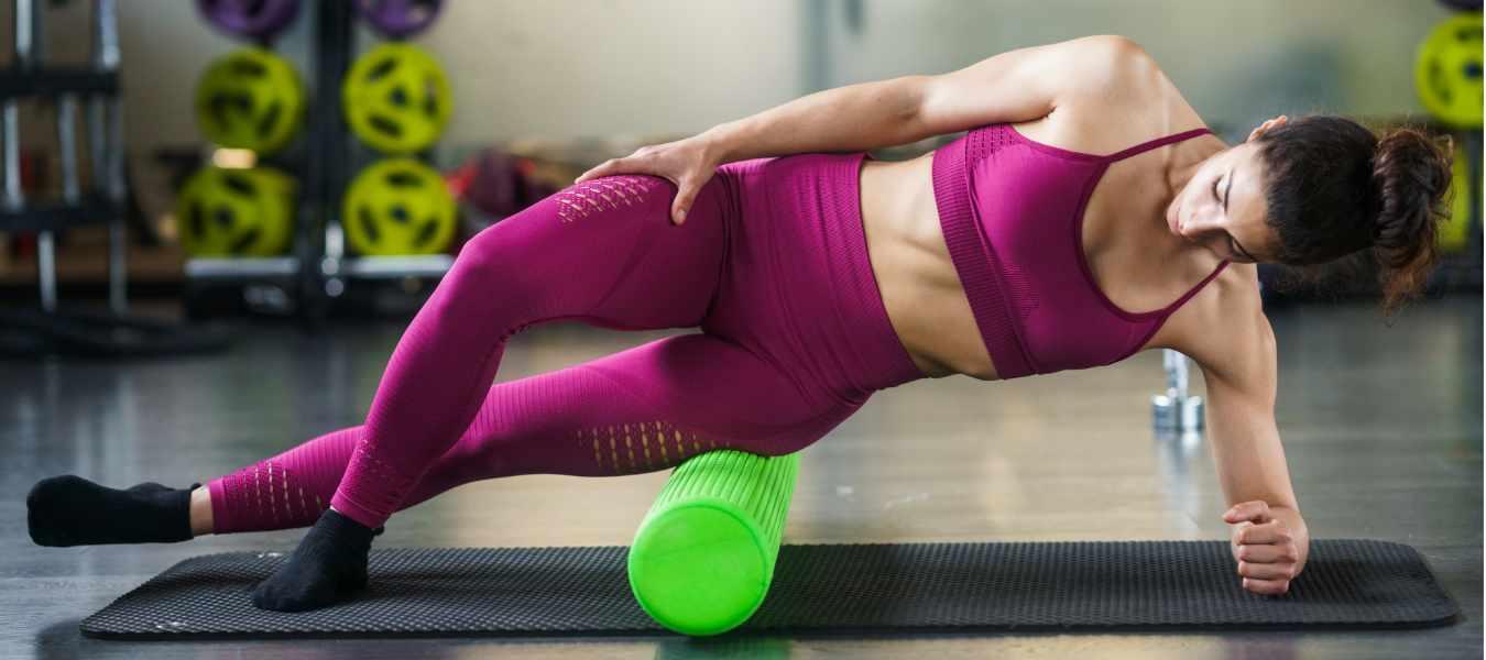 woman using foam roller